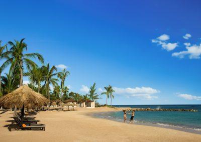 Hyatt-Zilara-Rose-Hall-Couple-Playing-Beach